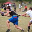 Female Flag Football Player Gets Grabbed By Defender - Stock Photo