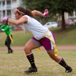 Female Flag Football Player Runs Pass Route - Stock Photo