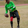 Foto Stock: WomPlays Quarterback On Flag Football Team
