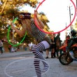 Female Street Performer Entertains With Three HulHoops — Stock Photo #17661085