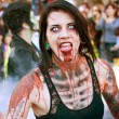 Female Zombie Makes Scary Face in Halloween Parade — Stock Photo #17661553