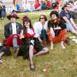 Постер, плакат: Hippie Zombies Relax And Drink Beer After Halloween Parade