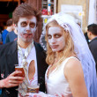 Zombie Bride And Groom Enjoy A Cold Beer - Stock Photo