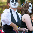 Zombie Woman Tosses Candy to Crowd At Halloween Parade — ストック写真