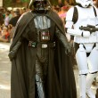 Darth Vader And Stormtrooper Walk In Halloween Parade - Stock Photo