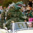 Stock Photo: Godzilla Waves To Crowd In Halloween Parade