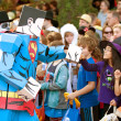 SupermCartoon Character Fist Bumps Kids At Halloween Parade — Foto Stock #17665531