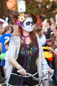 Hippie Zombie Rides Bike In Halloween Parade — Stock Photo