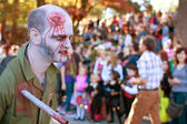 Male Zombie With Stab Wound Walks In Halloween Parade — Stock Photo