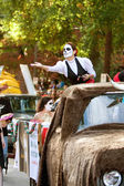 Female Zombie Tosses Candy To Crowd At Halloween Parade — Stock Photo