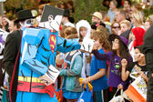 Superman Cartoon Character Fist Bumps Kids At Halloween Parade — Stock Photo