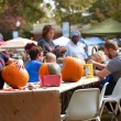 Stock Photo: Families And Children Carve Halloween Pumpkins