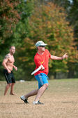 Young Male Plays Ultimate Frisbee In Park — Stock Photo