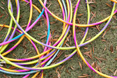 Colorful Hula Hoops Form Circles Lying On Grass — Stock Photo