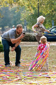 Father Takes Photo Of Toddler Playing With Hula Hoops — Stock Photo