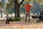 Father Watches Toddler Son Play With Hula Hoops — Stock Photo