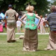 Stock Photo: Compete In Sack Race At Spring Festival