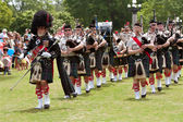 Bagpipes Band Marches And Plays At Spring Festival — Stock Photo