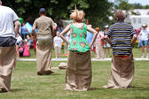 Compete In Sack Race At Spring Festival — Stock Photo