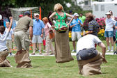 Jump In Sack Race At Spring Festival — Stock Photo