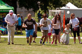 Several Compete In Egg And Spoon Race At Festival — Stock Photo