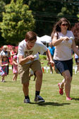 Two Run In Egg and Spoon Race At Festival — Stock Photo