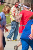Zombies Chase Runners In 5K Race — Stock Photo