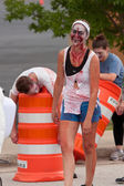 Female Zombie With Bloody Face Stalks Runners In 5K Race — Stock Photo