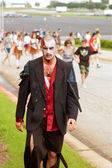 Male Zombie Rests After Chasing Humans In 5K Race — Stock Photo