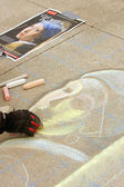 Chalk Artist Sketches Portrait Onto Sidewalk — Stock Photo