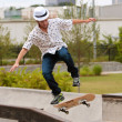 Man Practices Skateboard Trick On Railing — Stock Photo #27861839
