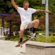 Stock Photo: MPractices Skateboard Trick At Park