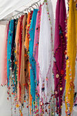 Colorful Beaded Scarves Hang In Vendor Booth At Festival — Stock Photo