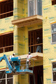 Construction Workers Work On Balcony At Condo Housing Development — Stock Photo