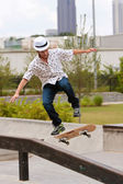 Man Practices Skateboard Trick On Railing — Stock Photo