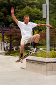 Man Practices Skateboard Trick At Park — Stock Photo