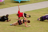 Work Out On Grass In Fitness Boot Camp — Stock Photo