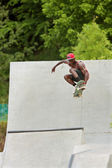 Teen Catches Big Air Skateboarding Off Concrete Ramp — Stock Photo
