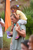Dad Carries Daughter On Shoulders At Summer Butterfly Festival — Stock Photo