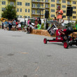 Kid Steers Car Down Hill In AtlantSoap Box Derby — Stock Photo #29979077