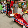 Kids Wait By Cars Before Racing In Soap Box Derby — Stock Photo #29979199