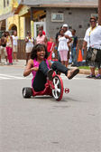 Woman Rides Big Wheel Tricycle Down Atlanta Street — Stock Photo