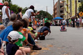 Spectators Cheer As Child Races in Soap Box Derby — Stock Photo