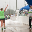 Runners Get Soaked By Squirt Guns At Race Finish Line — Stock Photo