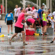 Stock Photo: MThrows Water Balloon In Group Fight After 5K Race
