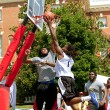 Stock Photo: MAttacks Basket Against Defender In Outdoor Basketball Tournament