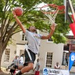 Stock Photo: MAttempts Slam Dunk During Outdoor Street Basketball Tournament