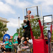Stock Photo: MElevates Above Rim In Outdoor Street Slam Dunk Contest