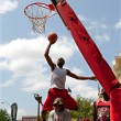Stock Photo: Young MJumps Over Person Attempting Jam In Dunk Contest