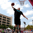 Man Leaps To Jam Basketball In Outdoor Slam Dunk Contest — Stock Photo